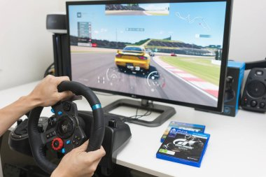 Playing racing video game at home