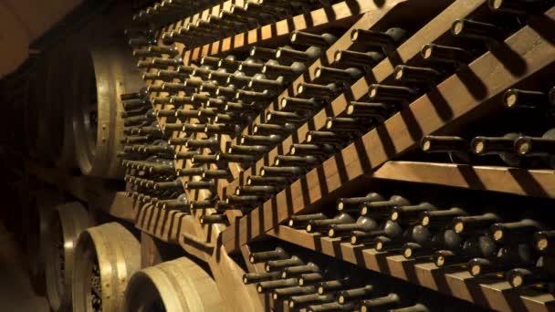 Wine bottles in wine cellar.