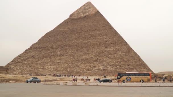 Giza , Egypt - January 14, 2020 : Tourists near Chephren Pyramid in Giza