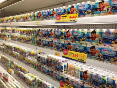 KUALA LUMPUR, MALAYSIA -JULY 30, 2019: Yogurt drinks and other dairy product displayed for sale in the huge open chiller. Arranged by type and brand to make easy for the customer.