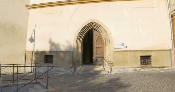 Entering a Catholic medieval Gothic arcade portal church door.