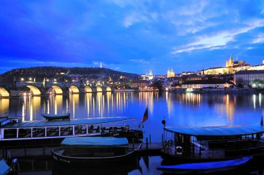 Night panorama of Prague Castle, Charles Bridge and Vltava pier at Czech Republic