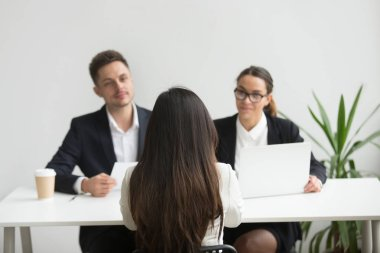 Headhunters interviewing female job candidate