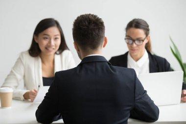 Male candidate interviewed by diverse HR team