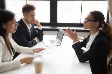 Confident applicant being judged by interviewing HR managers