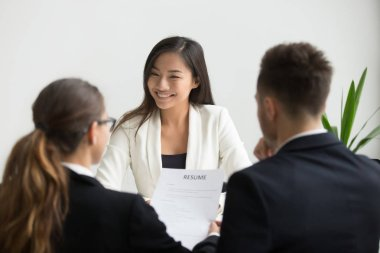 Confident beautiful millennial asian applicant smiling at job in