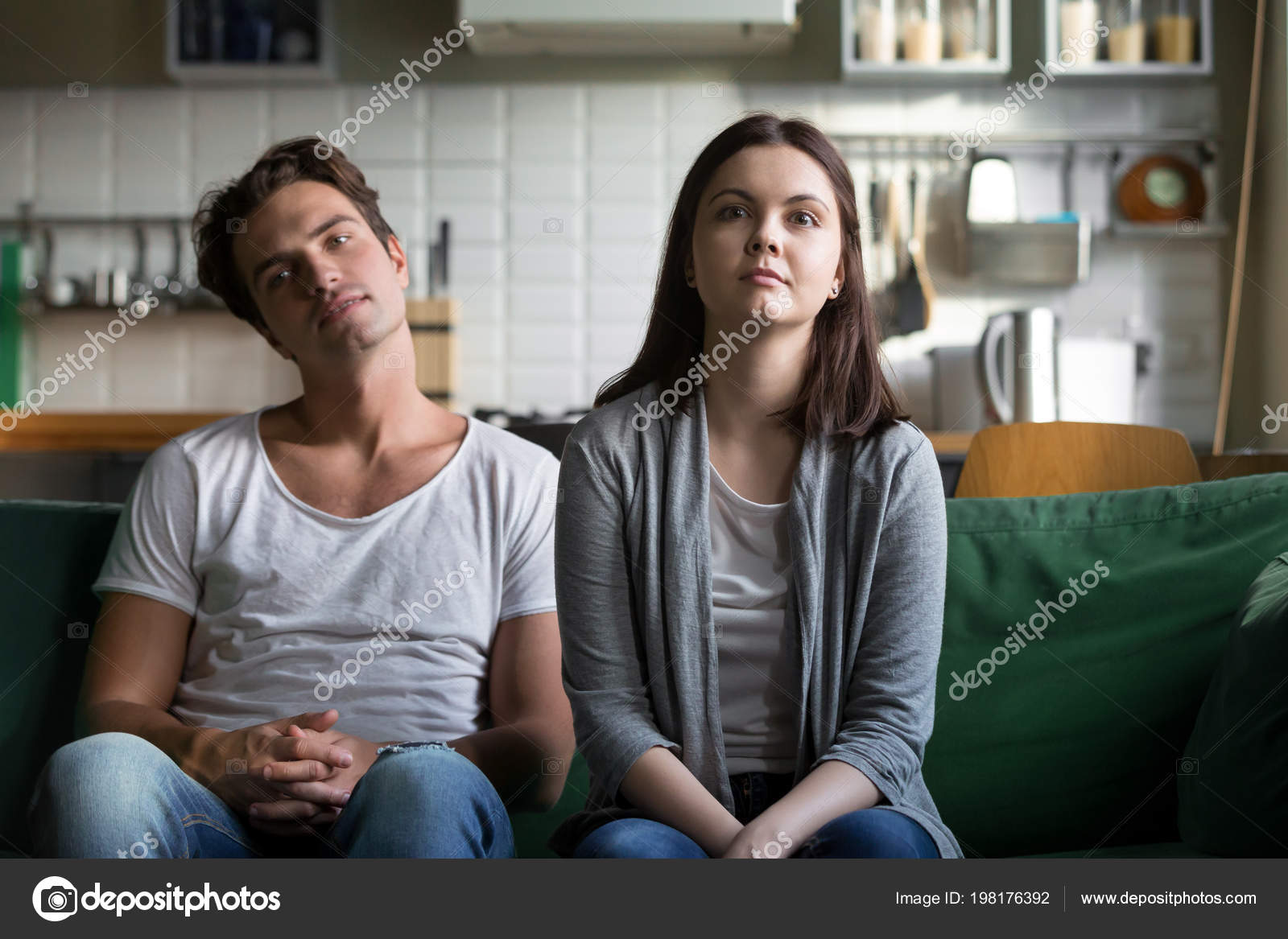 Lazy millennial couple getting bored at home sitting on sofa — Stock ...