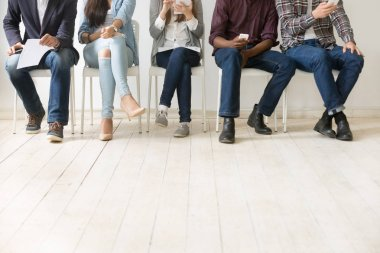 Bottom view of diverse work candidates waiting for job interview