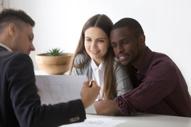 Male real estate agent or consultant showing house plan to happy millennial multiracial couple buying first home together, architect discussing apartment design with spouses or young family stock vector