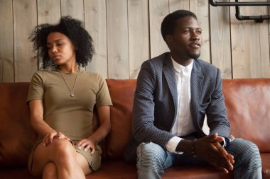 Black spouses sitting on couch aside not ready to compromise