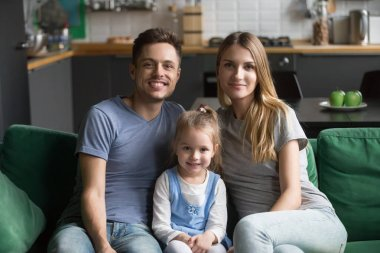 Portrait of happy healthy loving family with kid daughter