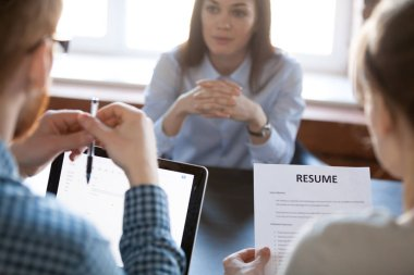 HR team thinking considering woman candidature during interview
