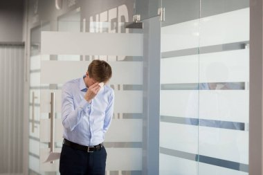 Nervous male worker stressed before making presentation in meeti