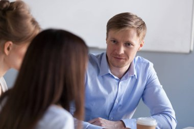 Diverse millennial colleagues have talk during office break