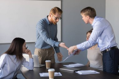 Angry coworkers disagree about contract terms and conditions