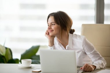 Smiling happy businesswoman feeling motivated dreaming about fut