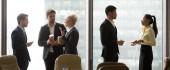 Fotografie Multiracial, business people talking in break, standing near win