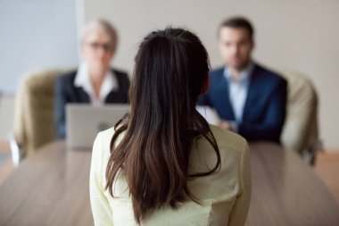 Businesswoman and businessman HR manager interviewing woman