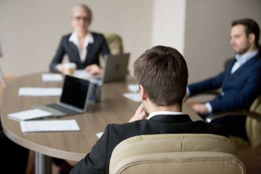 Business people at meeting in office at boardroom negotiate