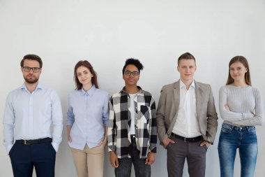 Group of young business people standing looking at camera