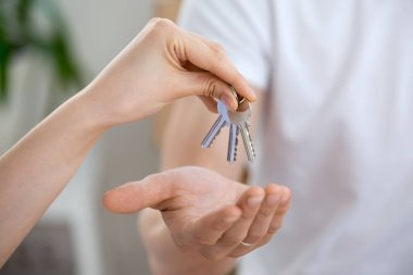 Man receiving keys from real estate agent