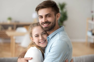 Sincere just a married couple in love hugging. Head shot portrait husband and wife embracing spend free time together at home on weekend looking at camera. Romantic relationships and dating concept stock vector