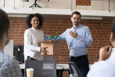 Friendly company ceo welcoming african employee in multiracial o