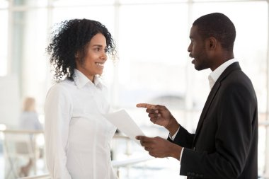 African American businessman promote excited female meeting in h