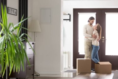 Couple arrived at new house with cardboard boxes