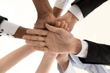 Diverse business people hands in pile, corporate unity, below vi