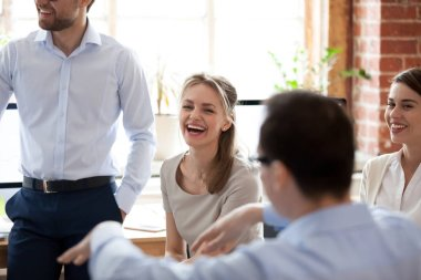Happy laughing businesswoman at briefing, company meeting