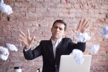 Angry tired businessman quits job, throws crumpled paper