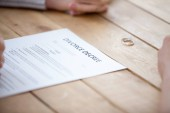 Photo Close up of couple sign divorce papers at lawyers office