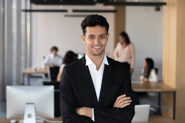 Middle eastern ethnicity businessman in suit posing in coworking