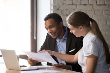Female financial advisor insurer consulting male african-america