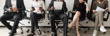 Horizontal image diverse applicants sitting in queue waiting job interview