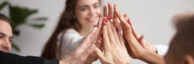 Horizontal closeup photo business team feels happy giving high five
