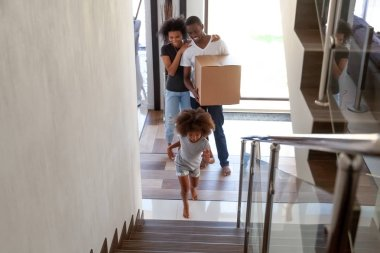African child exploring new house moving in with parents