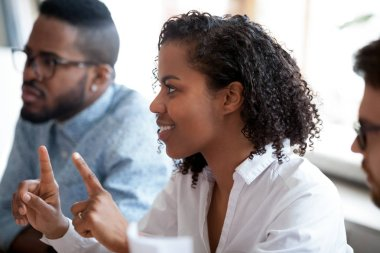 African american female worker involved in team discussion brainstorm