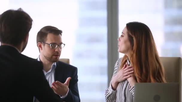 Business partners disputing on contract terms during group negotiation