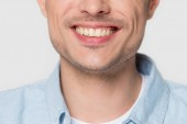 Close up of European male smile isolated on grey background