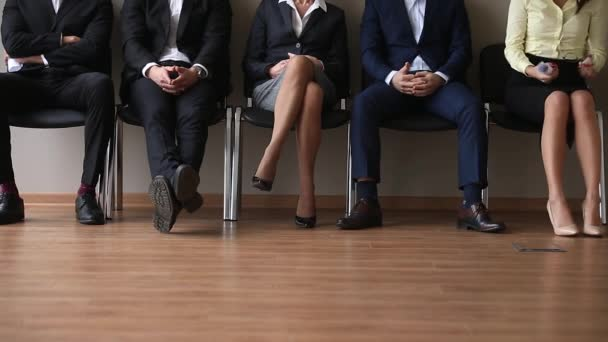 Jobless applicants group sitting in queue waiting for job interview