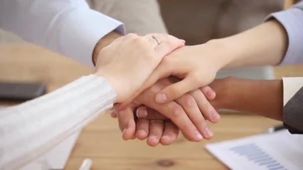 Diverse people student team stacking hands together in pile