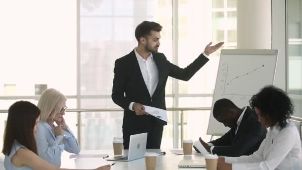 Mad manager boss scolding employees group shouting at office meeting