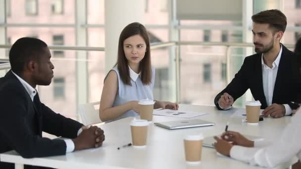 Confident businesswoman having business discussion with colleagues at office briefing