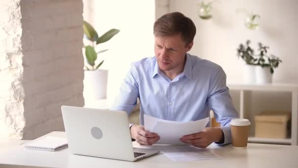 Businessman feels stressed about report mistake and computer software error