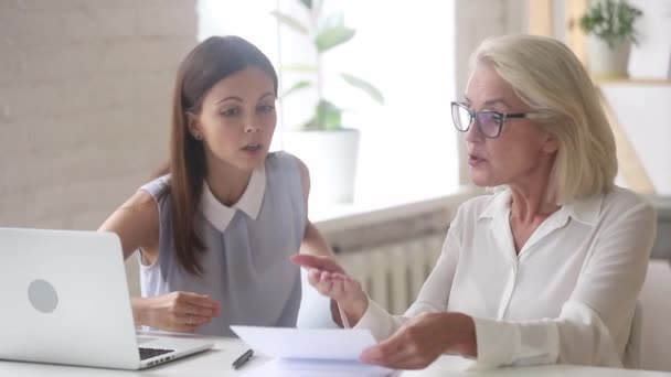 Angry old client arguing meeting young manager on insurance dispute