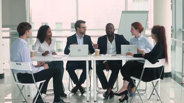 Diverse business people group brainstorm in teamwork at conference table