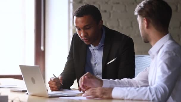 Happy african client handshake caucasian manager sign business contract