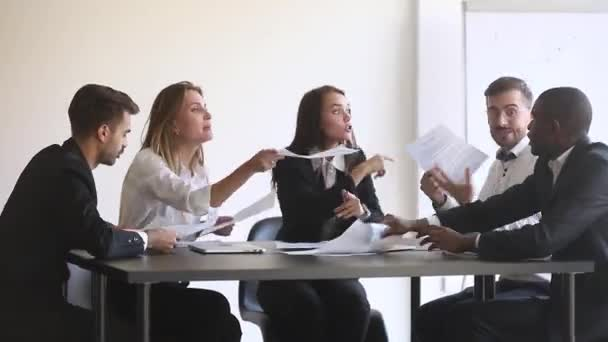 Angry diverse team colleagues argue over paperwork during company meeting